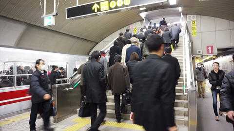 Osaka, japan: march 2015: Japanese commuter walking rushing in subway and train station walkway Footage