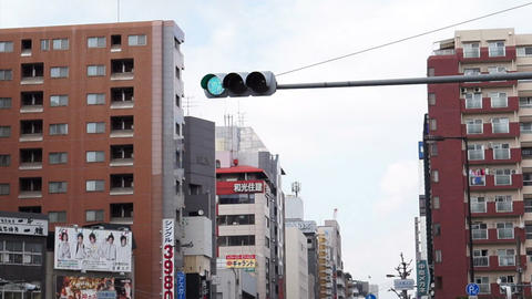 OSAKA, JAPAN -March 2015: View of traffic and people moving through the city busy streets with view Live Action