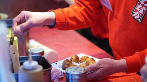 Cooking takoyaki Japanese octopus flour ball. Traditional Japan snack cuisine Footage
