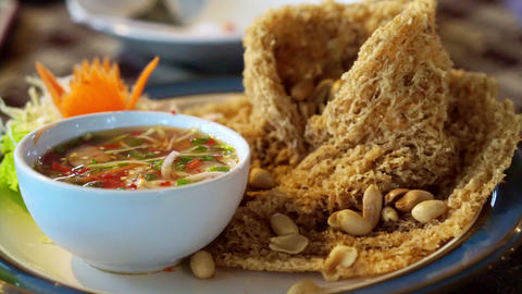 Fried catfish spicy salad, Asian Thai cuisine food. Serve with sweet and sour sp Footage