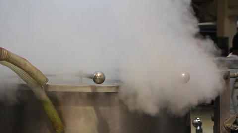 Steam escapes from the metal tank Live Action