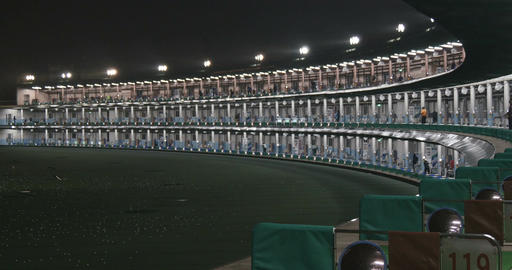 Midnight Golfers Enjoy The Practice Range At Lotte Kasai Golf stock footage