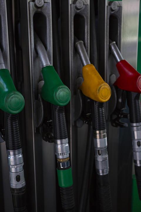 pistols on a fuel column Fotografía