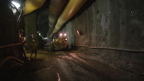 Large construction trucks working inside a tunnel Footage