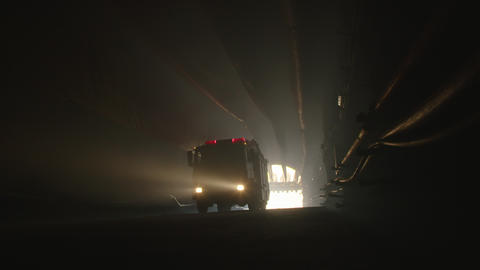 rescue truck driving into a dark construction tunnel Footage