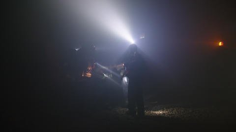 Rescue forces search for survivers inside a dark tunnel using flashlights Footage