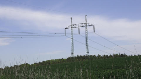Large view on the powerlines on the field. High voltage post or high voltage Footage