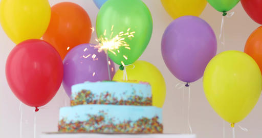 Blue Birthday cake with sparkler and colorful balloons Stock Video Footage