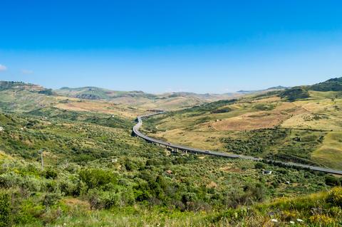 Four-lane highway spiraling through the countryside Photo