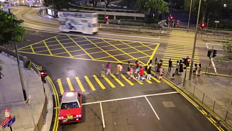 Traffic at the Night Crossroad of Hong Kong. Fast Motion Footage