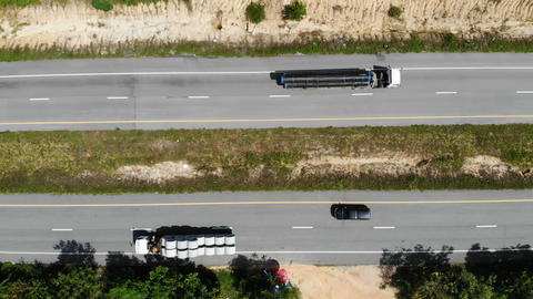 Drone shot high angle Aerial view of highway traffic at the countryside, The car truck and ライブ動画