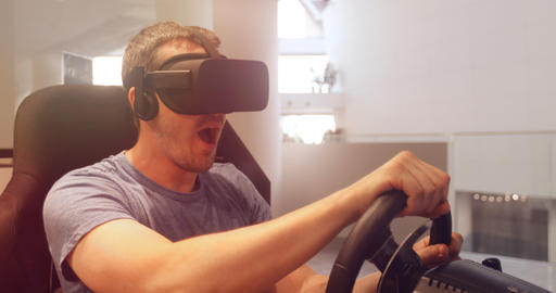 Computer simulation. Man in vr glasses racing steering wheel Fotografía