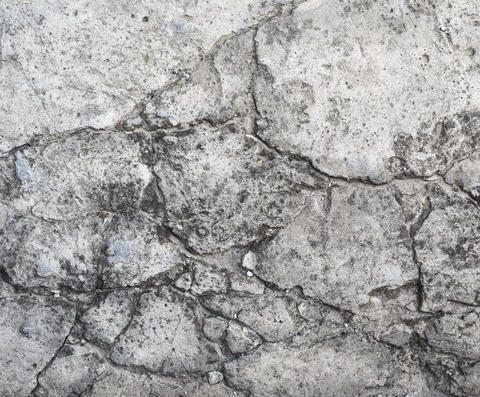 old gray cement wall with cracks Fotografía