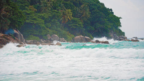 sea waves on a tropical island. rocky rocky shore, Spray Footage