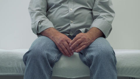 Senior man sitting on a couch in doctor's office Footage