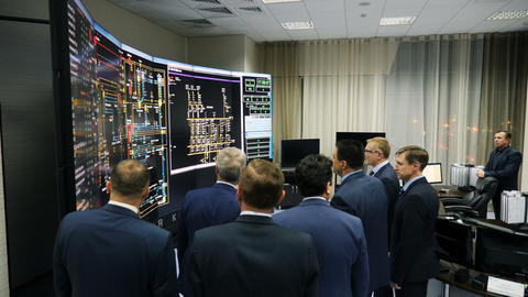 top managers look at technical presentation on large stand ビデオ