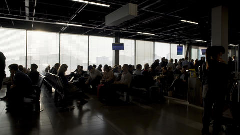 Passengers sitting at departure lounge and waiting for boarding, terminal Footage