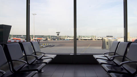 Beautiful view of empty seats at departure lounge, airport terminal, travel Footage
