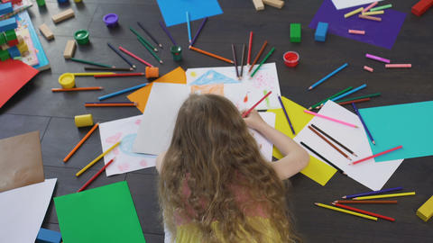 Leisure time of little blond girl drawing with colorful pencils, childhood Footage
