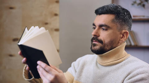 Conservative man frantically looking for his money stash among books, savings Live Action