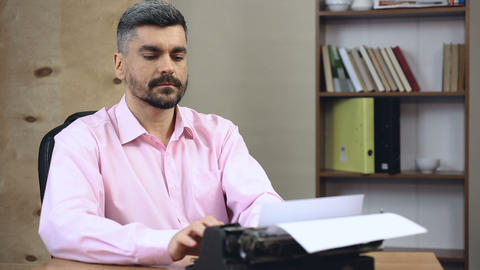 Conservative author giving up typing on laptop, taking out old typewriter Live Action