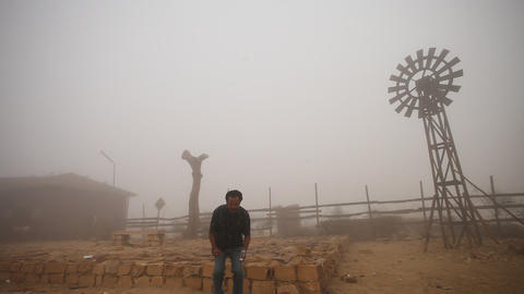 windmill at desert in mist Footage