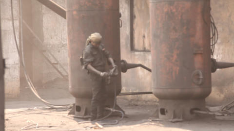 People working in the Iron ore factory Footage