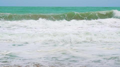 slow motion, sea waves on the coast of a tropical island GIF