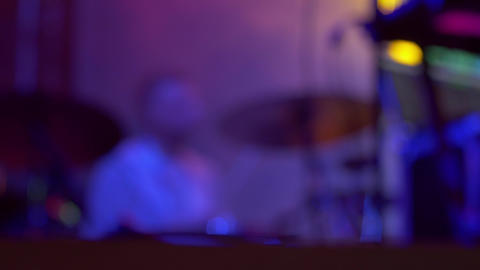 Drummer on stage during concert at night - blurry defocused concept video Footage