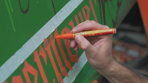 Close-up painting on canvas during open-air street festival of arts ライブ動画
