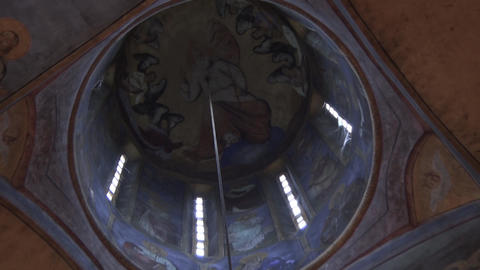 Interior of the Orthodox Church: a dome with icons, Luster and Altar ビデオ