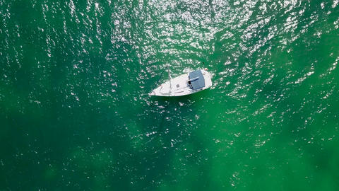 Aerial Top View Of A Isolated Sailboat In The Sea Water Footage