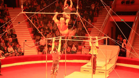 Group of gymnasts performing unimaginable tricks on horizontal bars in circus 영상물