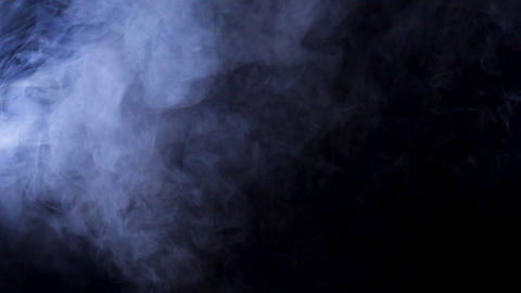 Smoke flying over a black background Footage