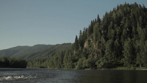 Fast flowing water in the mountain river. Beautiful Altai landscape.The Altai Footage