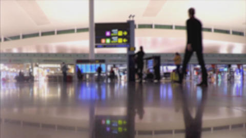Blurry People In Bright Airport Terminal Interior GIF