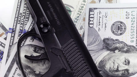 Cash one hundred dollar bills under the gun, rotating background Footage