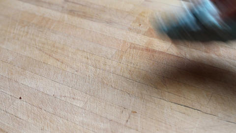 Hands of a woman cleaning a chopping board Stock Video Footage