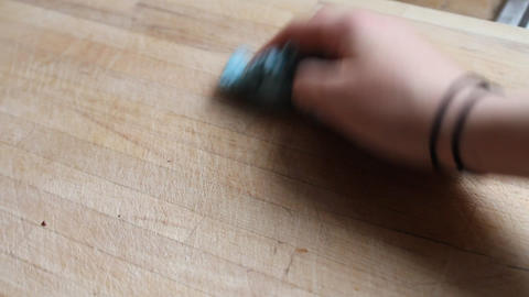 Hands of a woman cleaning a chopping board Footage