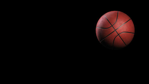 Basketball, Rotation on black background, loop Stock Video Footage