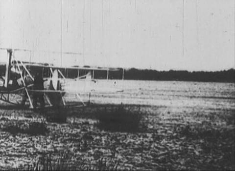 The first aircraft, a newsreel Stock Video Footage