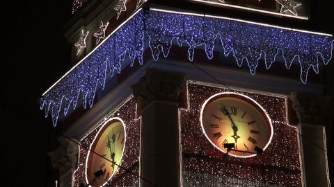 The clock on the tower with garlands Stock Video Footage