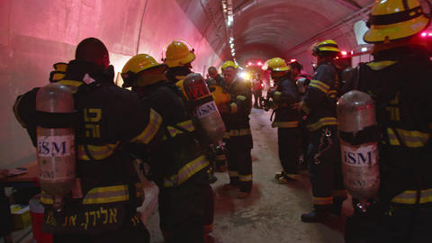 Yokneam, Israel, July 17 2018 - Firefighters during drill in a tunnel ビデオ