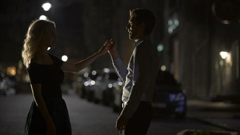 Couple of lovers dancing in empty night street, dating and love, seduction Footage