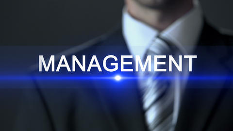 Management, male in business suit touching screen, business strategy, company Live Action