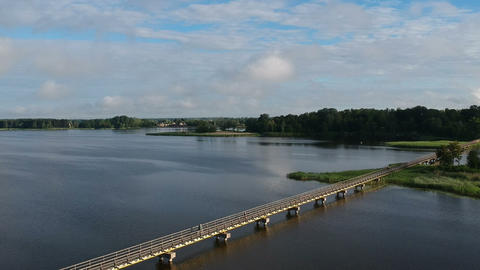 lake with long wooden bridge, aerial view Footage