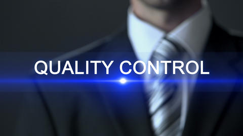 Quality control, businessman in suit touching screen, safe manufacturing, check ビデオ