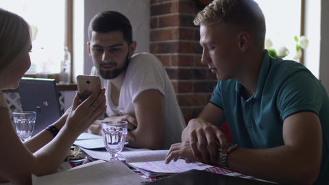 Four students preparing to exams at university in cafe Footage