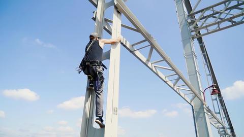 Guy climbs on the bridge for a jump Live Action
