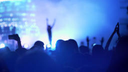 Heads of people at rock concert, bright colorful illumination Footage